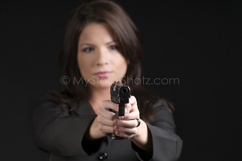 Woman with hand gun