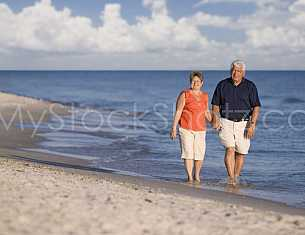 Couple walking the beach in Gulf Shores, Alabama