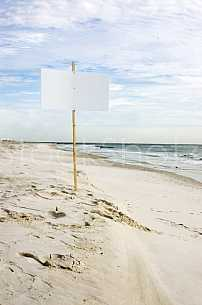 blank sign on beach
